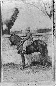 Image: Public Domain/Library of Congress/Tad Lincoln on pony between 1860 and 1865