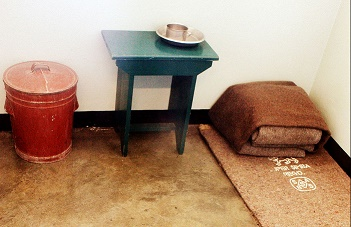 Image:  Creative Commons Attribution-Share Alike 3.0 Unported/Wistinkhou/Nelson Mandela's prison cell on Robben Island
