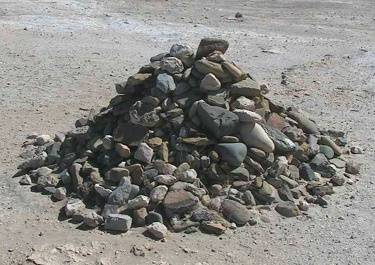 Image:  Creative Commons Attribution-Share Alike 3.0 Unported/ 	D. Gordon E. Robertson/ Pile of rocks started by Nelson Mandela and added to by former prisoners of Robben Island Prison, South Africa