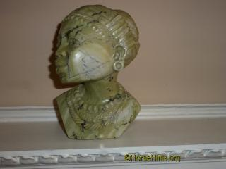 Butter Jade carving of a traditional woman.